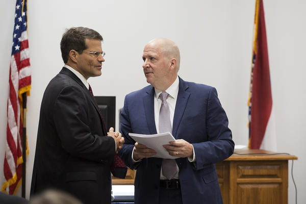 Missouri Solicitor General John Sauer, left, and Planned Parenthood attorney Chuck Hatfield speak during a break on the first day of a hearing that could determine the fate of Missouri's sole abortion clinic.