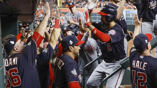 The Washington Nationals congratulate Anthony Rendon after his two-run home run during the seventh inning of Game 6 of the World Series against the Houston Astros on Tuesday.