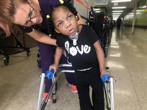 Carmen is learning to walk at Children's Habilitation Center.