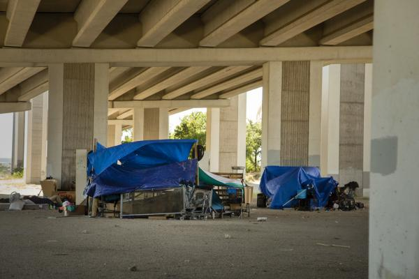 Temporary shelters and materials gathered under an overpass at Ben White Boulevard and Victory Drive could be cleared out by the Texas Department of Transportation Monday, according to the governor's office.