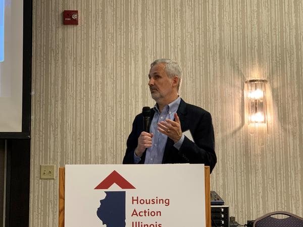 Larry Pusateri, vice president of the Lightengale Group, presents on the barriers to affordable housing at the Housing Action Illinois conference in Bloomington on Thursday, Oct. 24, 2019.