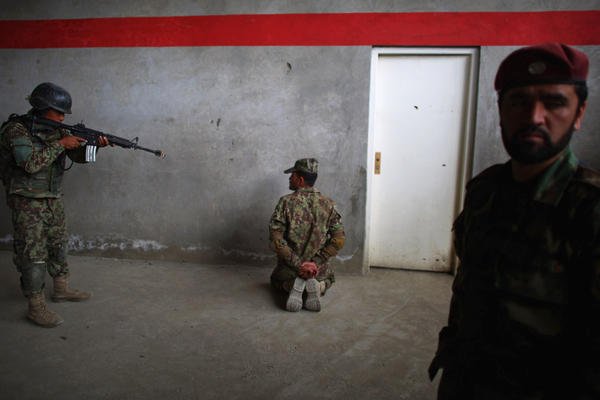 Commandos stream into a warehouse-like building divided into rooms. They practice shooting at Taliban role-players, frisking those with their hands up. In a month or so, they'll be doing it for real.