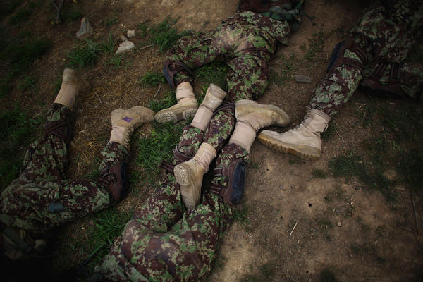 Commandos' legs are jumbled together as they lie prone during a training exercise at Camp Commando.