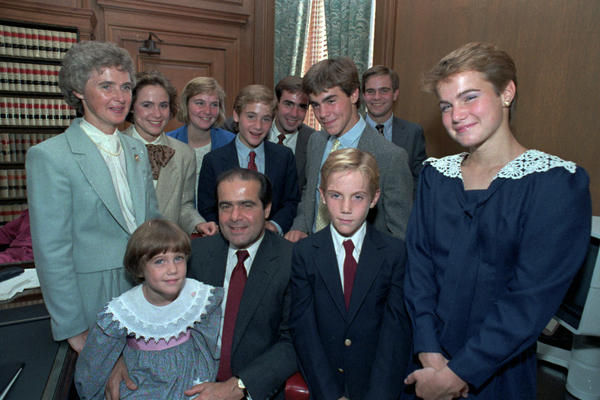 Supreme Court Associate Justice Antonin Scalia poses with his family in his chambers before court ceremonies in 1986 in Washington, D.C. (Front row, from left) Margaret Jane; Justice Scalia, Christopher and Mary. (Back row, from left) Mrs. Scalia, Ann Forrest, Elizabeth, Matthew, Eugene, John and Paul.