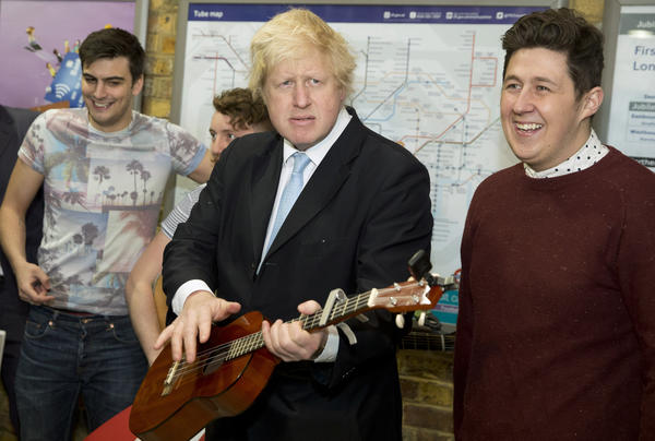 London Mayor Boris Johnson plays a guitar at an event to promote street performances in the city in March 2015. Johnson has broken ranks with Prime Minister David Cameron, a fellow Conservative Party member, by calling for Britain to leave the European Union.