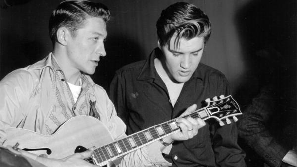 Guitarist Scotty Moore, left, helped define Elvis Presley's early sound. Moore died June 28.
