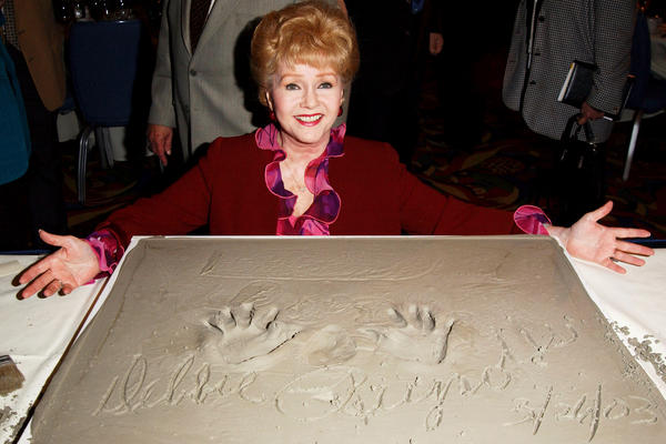 Debbie Reynolds poses at the Chamber of Commerce luncheon in Century City, Calif., in 1983.