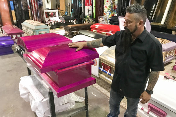 A casket is painted shiny pink for a little girl who died in Sunday's massacre in Sutherland Springs, Texas.