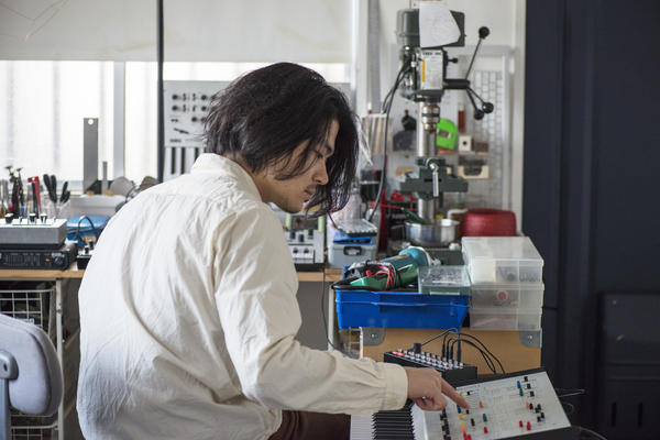 Tatsuya Takahashi at his home workshop in early 2017, surrounded by a few of his signature machines.