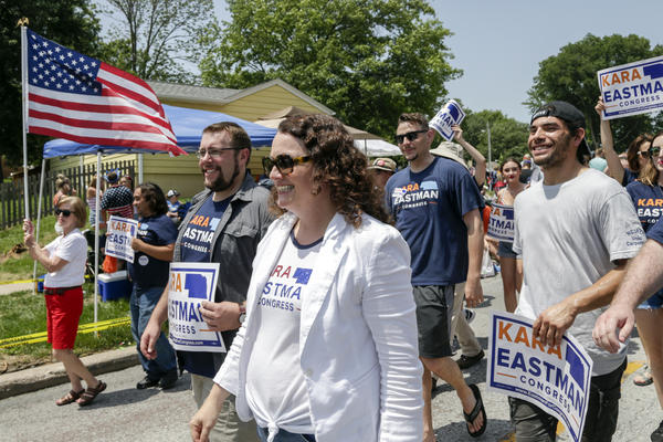 Democratic House candidate Kara Eastman participates in a 4th of July parade in Ralston, Neb. Women Democratic House candidates like Eastman are generally being significantly outraised by their male Democratic counterparts.