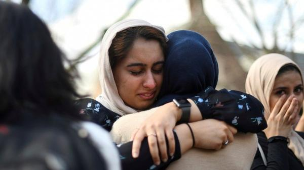 At the University of Pennsylvania in Philadelphia on Friday, Nayab Khan, 22, cries at a vigil to mourn for the victims of the Christchurch mosque attacks in New Zealand.