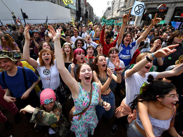 Activists call for government action on climate change in the middle of Oxford Circus on Wednesday in London. Now in their third day of action, protests have blocked a number of key junctions in central London.