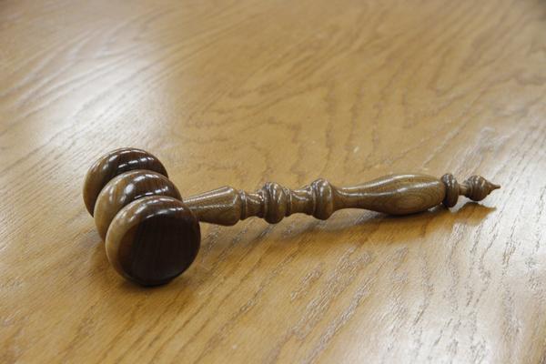 Photo by OpenRoadPR is licensed under CC 0. https://pixabay.com/en/gavel-wood-courtroom-legal-law-1017953/