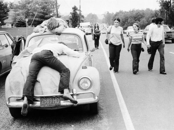 Two Woodstock attendees on their Volkswagen Beetle in 1969. An emblem of the hippie era in America, the car was marketed in the U.S. as adorably uncool.