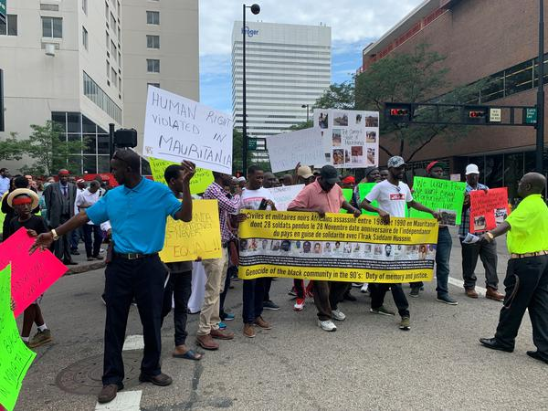 Community advocates march from Piatt Park to the National Underground Railroad Freedom Center to raise awareness of apartheid and slavery in Mauritania.