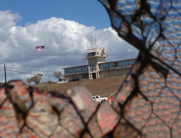An NPR investigation finds that the military court and prison at Guantánamo Bay, Cuba, have cost taxpayers billions of dollars, with billions more expected. The war court headquarters at Camp Justice, as seen through a broken window at an obsolete air hangar at the U.S. Navy base at Guantánamo Bay, Cuba, on February 28, 2015.