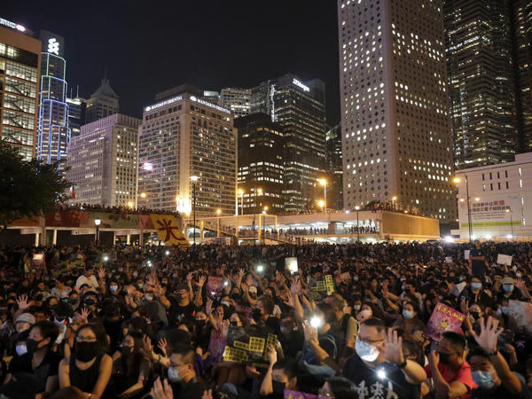 Protesters flash their smartphone lights as they stage a rally at Edinburgh Place in Hong Kong on Friday. This weekend marks five years since the pro-democracy Umbrella Movement formed.