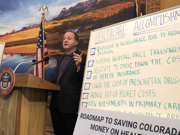 Gov. Jared Polis speaks to reporters about his administration's accomplishments on the final day of the 2019 legislative session.