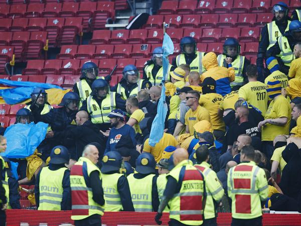 Brondby fans scuffle with police during a match between the Copenhagen and Brondby soccer teams at Copenhagen's Telia Parken stadium in 2017.