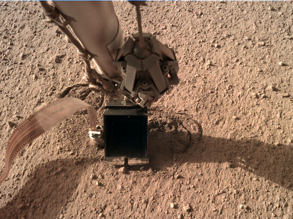"Instrument Deployment Camera on Mars InSight lander showing scoop ""pinning"" thermal instrument called the mole."