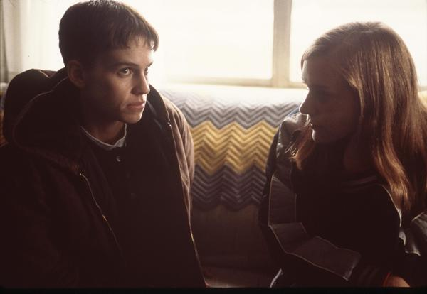 Hilary Swank (left) and Chloe Sevigny starred in <em>Boys Don't Cry</em>, a fictionalized portrayal of the transgender youth Brandon Teena (played by Swank).