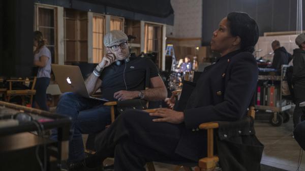 Damon Lindelof and star Regina King on the set of <em>Watchmen</em>.