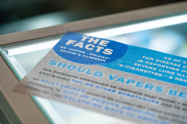 A flyer reminding customers about vaping-related deaths and illnesses, on display in a Seattle vape store. The Washington State Board of Health recently passed a four-month emergency ban on flavored vaping products. It applies to products that contain either THC or nicotine.