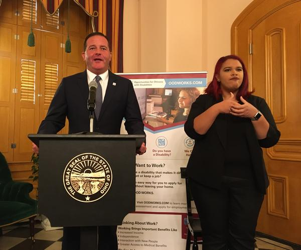 Opportunities for Ohioans with Disabilities director Kevin Miller announces the College2Careers program, with the assistance of a sign language interpreter.