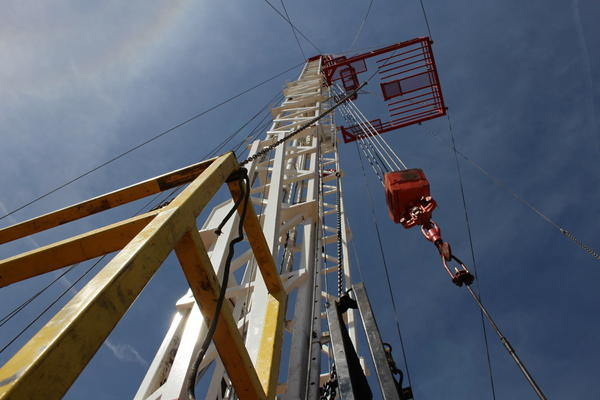 A workover rig in Adams County reaches into the sky. A new study from the Colorado Department of Public Health has stoked the conversation about health risks associated with living near active wells.