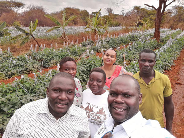 Noah Nasiali-Kadima, foreground, takes a selfie with members of the Africa Farmers Group during a tour of a member's farm in Machakos County, Kenya.