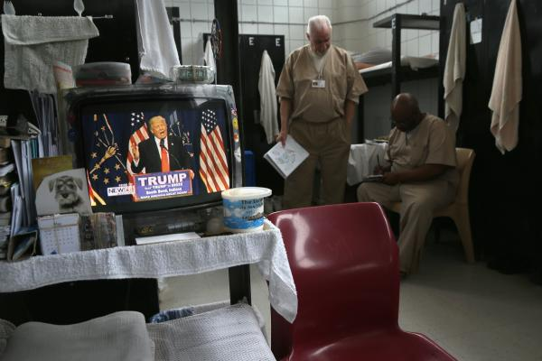 Television news features candidate Donald Trump over a prisoner's bunk at the Veterans Unit of the Cybulski Rehabilitation Center in Connecticut. Connecticut is one of only four states where voting rights are restored to convicted criminals immediately upon completion of their prison and parole time.