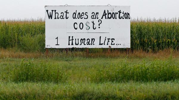 A roadside sign in rural Kansas.