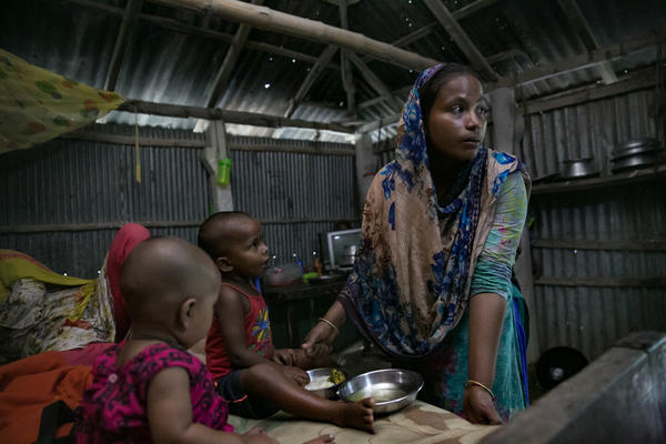 Reba Begum does housework at her home on a char near Rangpur, Bangladesh.
