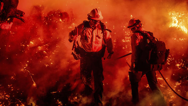 Firefighters battle the Maria Fire in California's Ventura County, which authorities said late Friday was 70% contained.