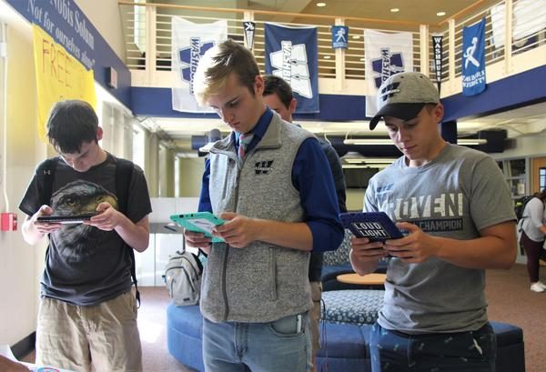 Students use electronic tablets to register to vote or update their addresses during a September registration drive at Washburn University.