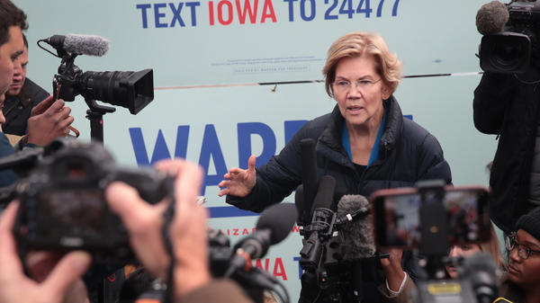 Sen. Elizabeth Warren speaks to reporters in Des Moines, Iowa, on Friday, after releasing her plan to pay for single-payer health care.