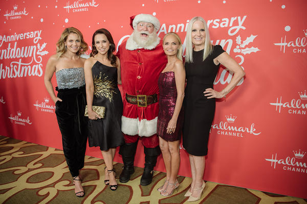 "(Left to right) Candace Cameron-Bure, Lacey Chabert, Kristin Chenoweth and Michelle Vicary arrive  at the Los Angeles special screening of Hallmark Channel's ""A Christmas Love Story"" at Montage Beverly Hills on Oct. 21, 2019 in Beverly Hills, Calif. (Morgan Lieberman/Getty Images)"