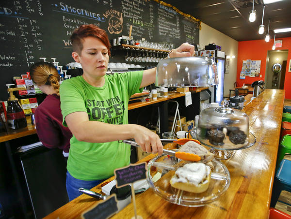Mandy Fincham and her husband, B, run the Kettle in Beloit, Kansas. Some people think it's quality-of-life initiatives like their cafe and wine bar make a difference between small towns shrinking smartly or withering badly.