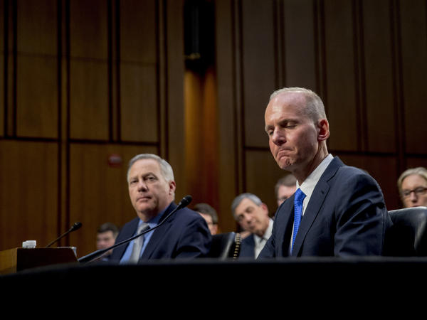 Boeing Company President and Chief Executive Officer Dennis Muilenburg, right, and Boeing Commercial Airplanes Vice President and Chief Engineer John Hamilton faced intense questioning about what the company knew and when.