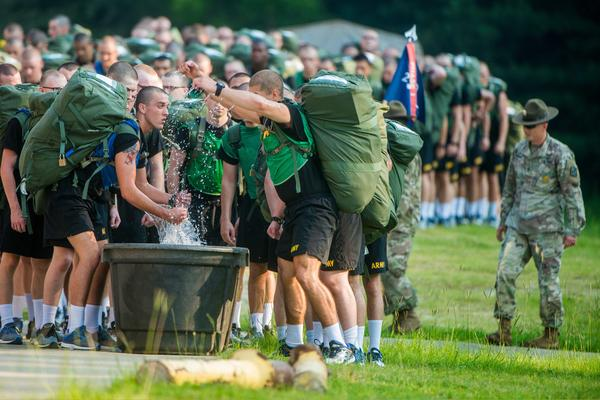 Soldiers at Fort Benning, Ga. use immersion troughs filled with ice and water to cool off during training in this 2018 photo.