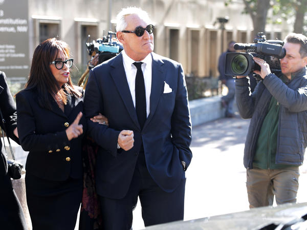 Roger Stone, a former adviser to President Trump, departs a Washington, D.C., courthouse with his wife on Monday. Stone faces charges that he allegedly lied to Congress and obstructed an official proceeding. Stone has pleaded not guilty, and his trial is set to begin Tuesday.