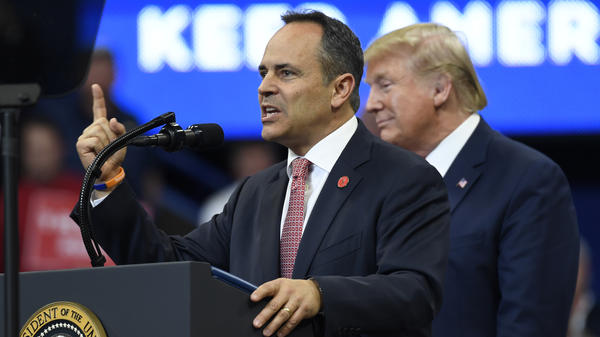 President Trump listens as Kentucky Republican Gov. Matt Bevin speaks during a campaign rally in Lexington, Ky., on Monday. Bevin is in a tight race for reelection.