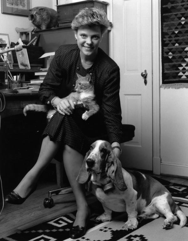NPR's Cokie Roberts is shown in her home office in 1990 with her dog, Abner, and cat, Tabasco.