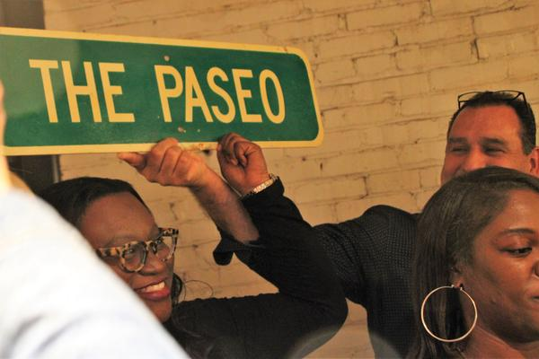 Former Kansas City councilwoman Alyssia Canady holds a sign at a victory party after voter approved undoing a measure to rename Paseo Boulevard after Dr. Martin Luther King, Jr.