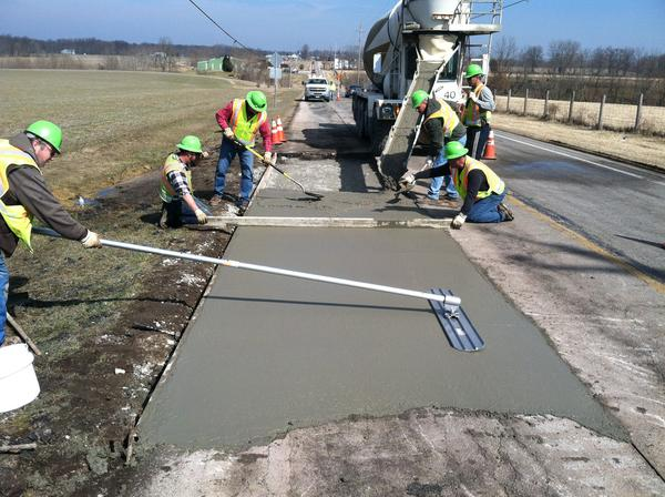 ODOT employees pour concrete. The department wants to hear ideas about the future of transportation in Ohio.