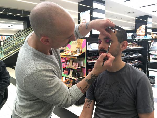 Reporter Darius Rafieyan gets his makeup done at a Sephora store in New York City. A growing number of American men are dabbling in cosmetics.