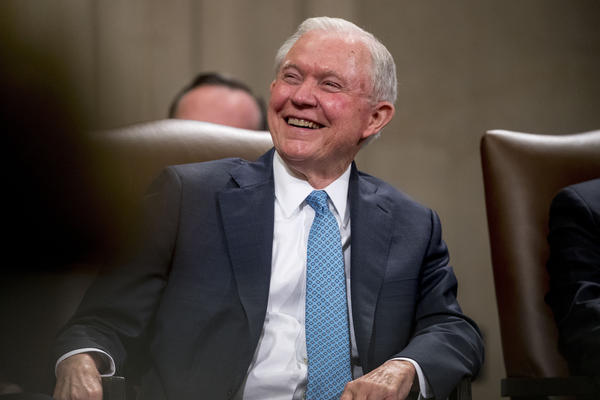 Former Attorney General Jeff Sessions smiles during a farewell ceremony for Deputy Attorney General Rod Rosenstein in the Great Hall at the Department of Justice in Washington, Thursday, May 9, 2019. (Andrew Harnik/AP)