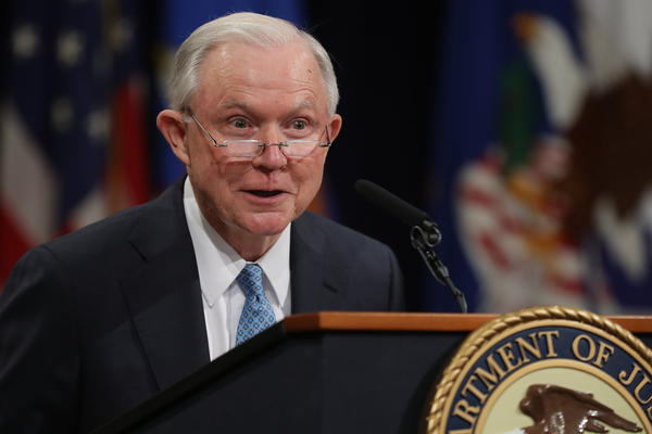 Former U.S. Attorney General Jeff Sessions delivers remarks during a farewell ceremony for Deputy Attorney General Rod Rosenstein at the Robert F. Kennedy Main Justice Building.