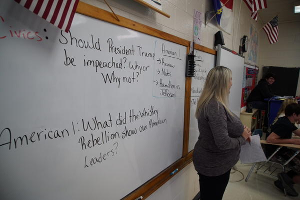 Civics teacher Aedrin Albright stands before her class at Chatham Central High School in Bear Creek, N.C., on Tuesday, Nov. 5, 2019. The class is debating whether President Trump should be impeached. The House impeachment inquiry into Trump's dealings with Ukraine has become a teachable moment in classrooms around the country as educators incorporate the events in Washington into their lesson plans.(Allen G. Breed/AP)