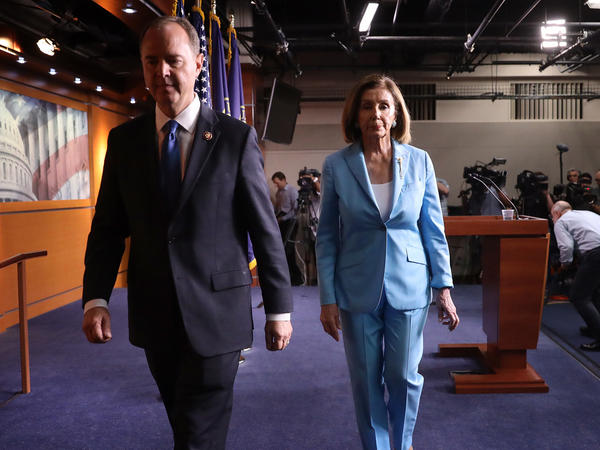Speaker of the House Nancy Pelosi, D-Calif., and Rep. Adam Schiff, D-Calif., depart a press conference at the Capitol on Oct. 2. The impeachment inquiry enters a new phase this week with the start of public hearings.